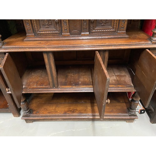 17 - An Impressive 17th Century style oak court cupboard unit. Showing detailed carved panel doors and tr...