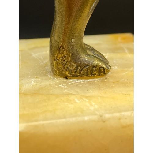 19 - An Art Deco gilt bronze dancing semi nude lady figurine. Displayed upon an alabaster base. Signed Va...