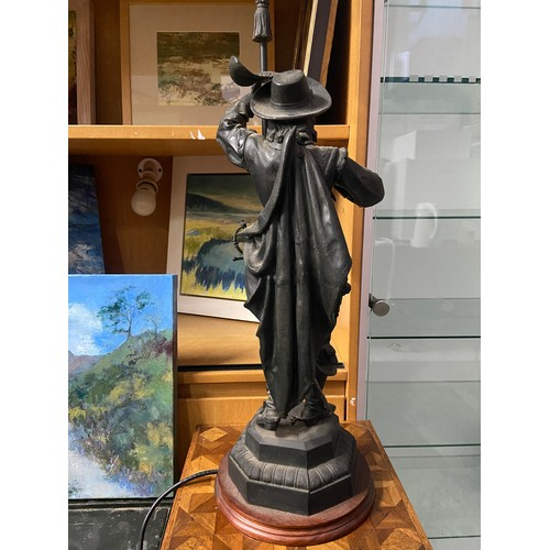 20 - A Victorian Spelter Cavalier figurine table lamp. Designed holding a lance which is topped by the et...