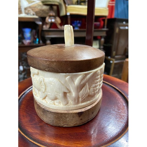 33 - An early 20th century ivory carved and wood preserve pot. [11cm to include top]...