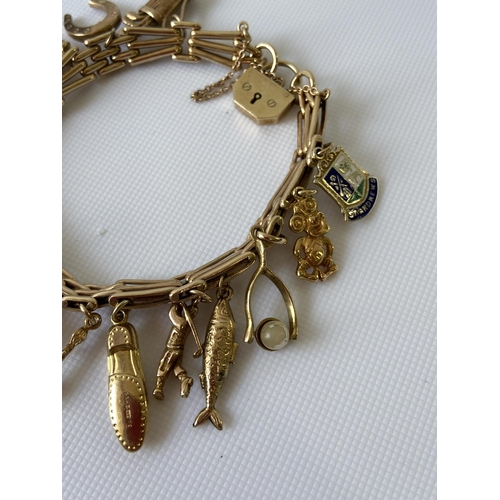 17J - A nice example of a vintage 9ct gold heavy charm bracelet to include; 14ct gold USA golf association...