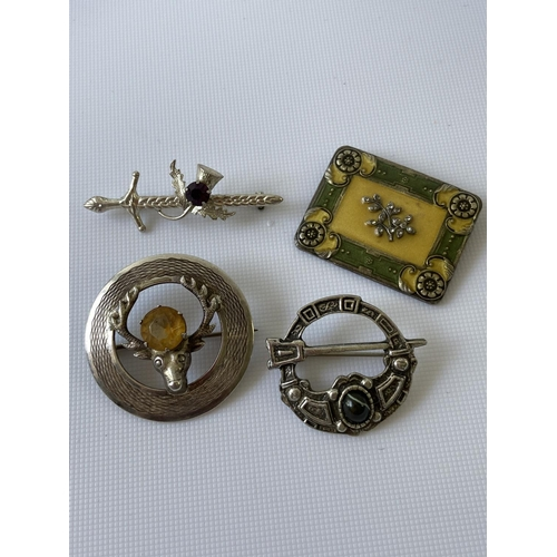 26J - A Glasgow silver stag & citrine brooch, Sterling silver sword brooch, pewter Celtic brooch and a Cat...