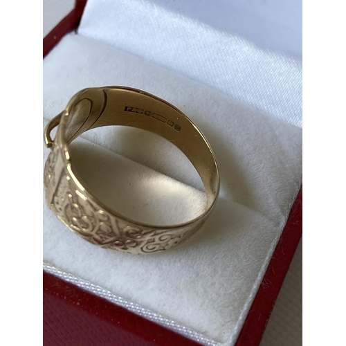 29J - A 9ct gold ornate buckle ring [size Q] [3.03g]...