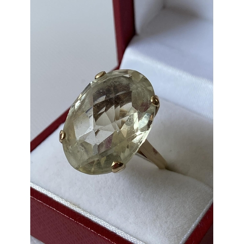 30J - A 9ct gold ladies ring set with a large clear stone [size M] [7.78g]...