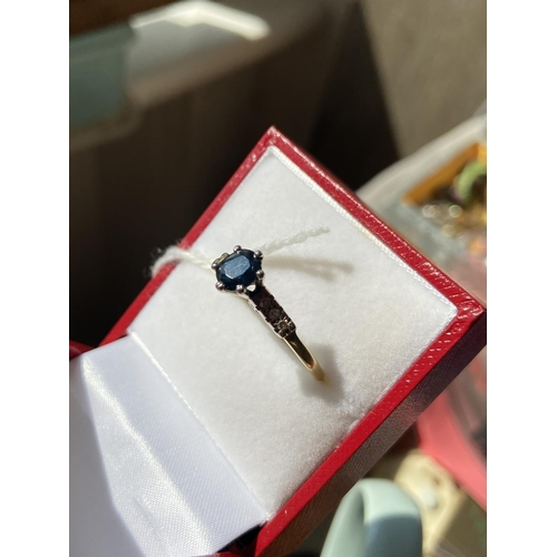 33J - An 18ct gold sapphire and 6 diamond stone ring [size S] [2.59g]...