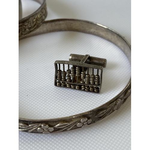 10J - 3 heavy silver flower design bangles, white metal snuff pendant and a pair of Sterling silver abacus...
