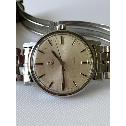 12J - A vintage gents Omega Geneve watch, fitted with a Seiko strap, in a working condition...