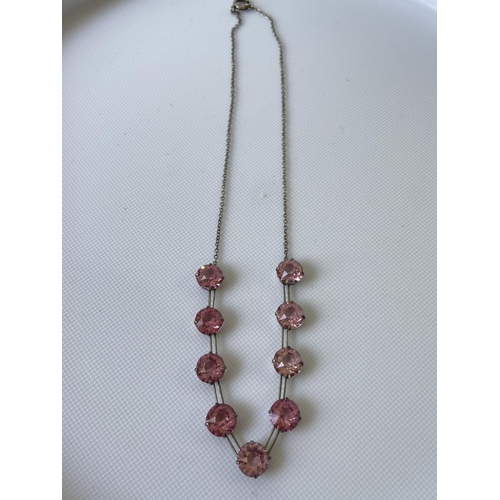 16J - A vintage white metal art deco necklace fitted with 9 large pink cut stones [length 35cm]...