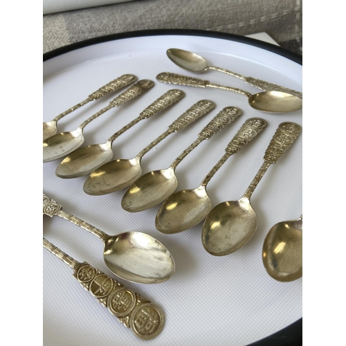 18J - A set of 12 vintage Chinese/Japanese silver tea spoons [75.93g]...