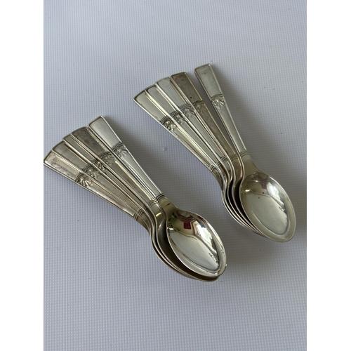 23J - A set of 10 Sheffield silver tea spoons [Walker & Hall] [98.46g]...