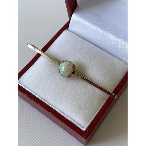 25J - An antique 9ct gold & opal stone bar brooch [length 5cm] [2.28g]...