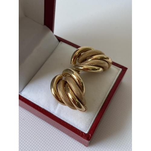 28J - A pair of 9ct gold earrings [3.9g]...