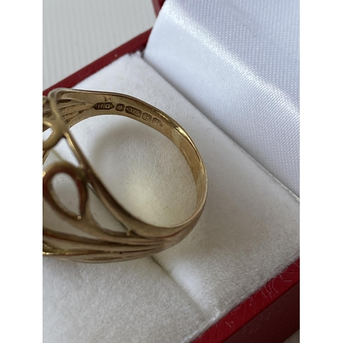 31J - A 9ct gold ladies ring set with a large yellow tone cut stone [size Q] [5.46g]...