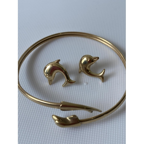 35J - A 9ct gold dolphin design bangle, together with a pair of dolphin earrings [6cm] [7.51g]...