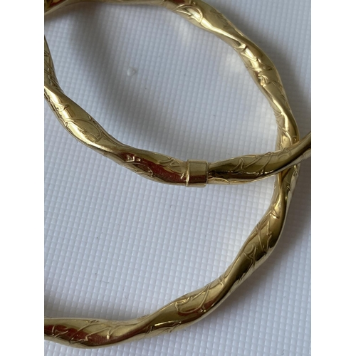 36J - A pair of 9ct gold dolphin design bangles [9.95g]...