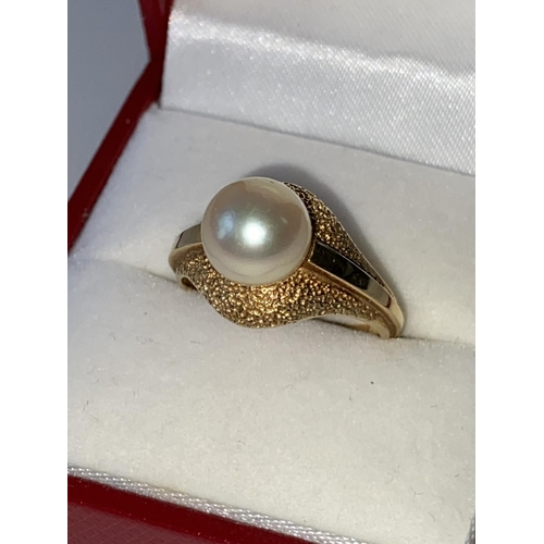 3J - A ladies 14k gold ring set with a single pearl setting, stamped [K14], [3.60g] [size L]...