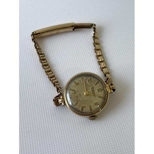 4j - A vintage 9ct gold Rotary case & strap [15.88g] together with a Swiss made watch, in a working condi...