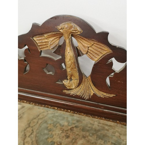 46 - A Georgian bevel edged and giltwood trim wall mirror with a pierced and carved wood extension to the...