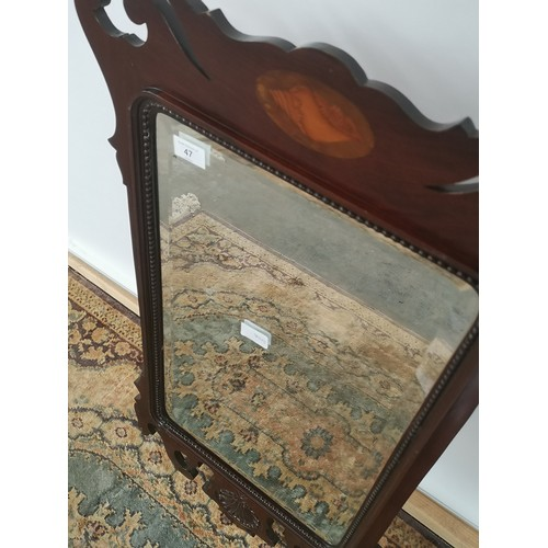 47 - A Georgian bevel edged and bead trim wall mirror, hand carved frame with a centre design to the uppe...