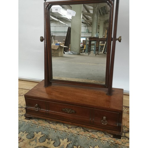 48 - A Georgian adjustable dressing mirror upon a one drawer concave base, on bracket feet...