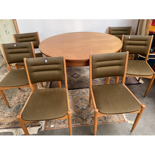 101 - A Stylish retro mid century teak table and six matching chairs. Possibly by McIntosh of Kirkcaldy. [...