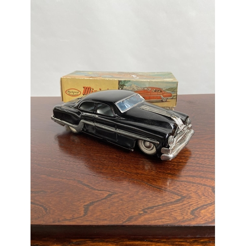 103 - A Vintage boxed Minister Delux Mechanical black model car [25cm in length]...