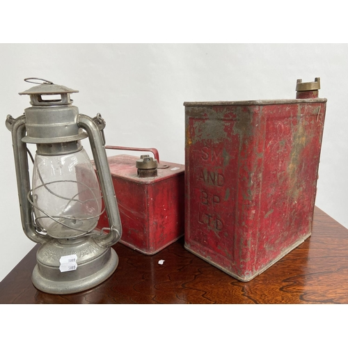 104 - A Selection of vintage lanterns and fuel cans to include BP Petrol can, small stove and unusual red ...