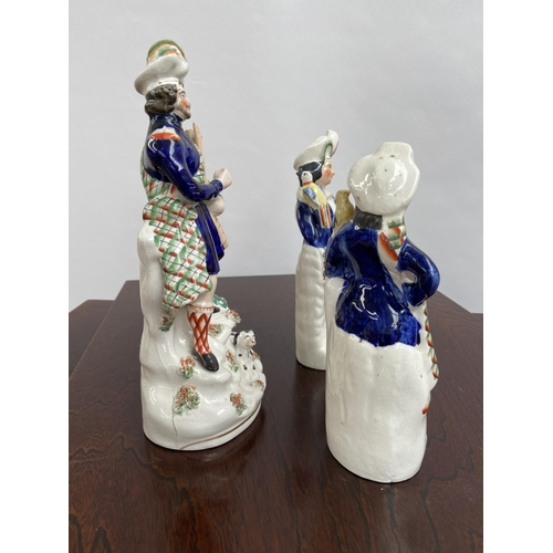 125 - A Lot of three Antique Staffordshire Scottish design figurines. [29cm in height]...