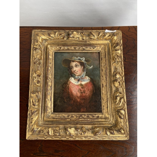 126 - An 18th/ 19th century oil painting on wood,  portrait of a lady, fitted within a moulded gilt frame....