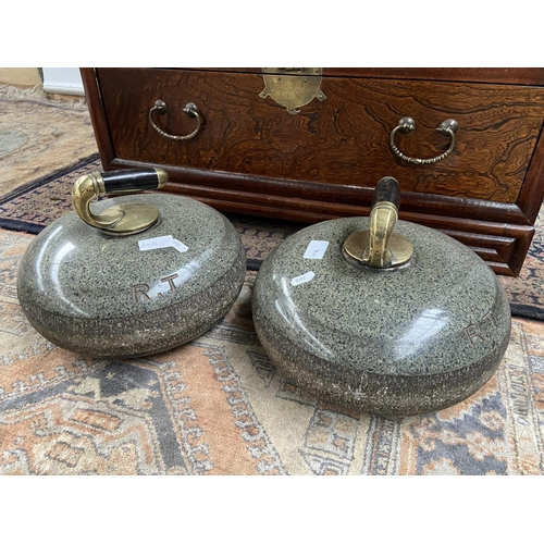 128 - A Pair of antique curling stones fitted with brass and ebony wood handles. Both engraved R.T....