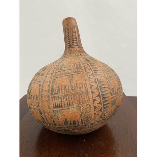 130 - A Large African Tribal hand carved nut water carrier. [36cm in height & 32cm in diameter]...