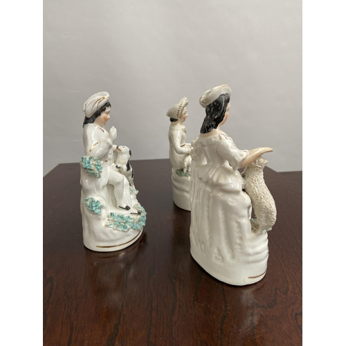 134 - A Lot of three antique Staffordshire seated figurines [15cm in height]