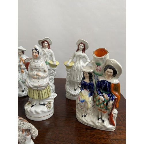 136 - A Collection of antique Staffordshire figurines to include young girl sat upon a rams back, Asian st...