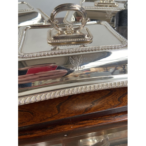 137 - A Collection of E.P and Silver plated wares to include serving tray, Tureens with lids, Brass candle...