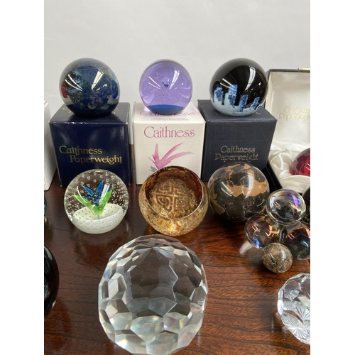 140 - A Collection of various paperweights to include unusual Caithness paperweights....