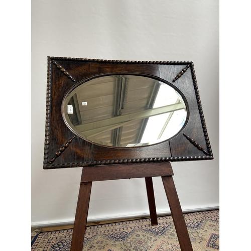 143 - An Antique Jacobean style wall mirror [73x52cm]...