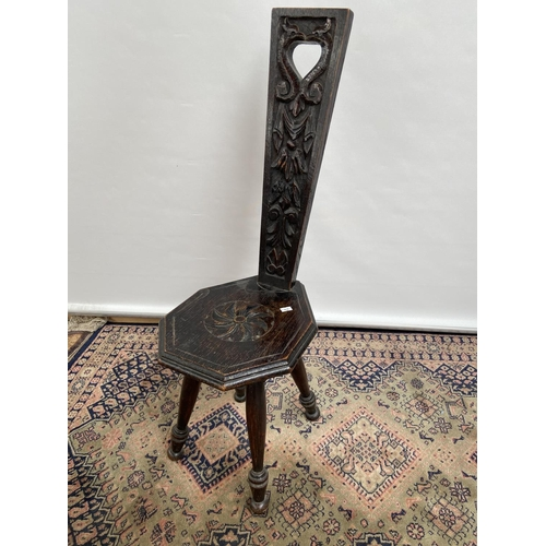 144 - A Vintage Arts and Crafts carved spinning wheel chair....