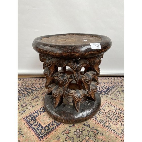 145 - A Tribal African hand carved stool/ table....