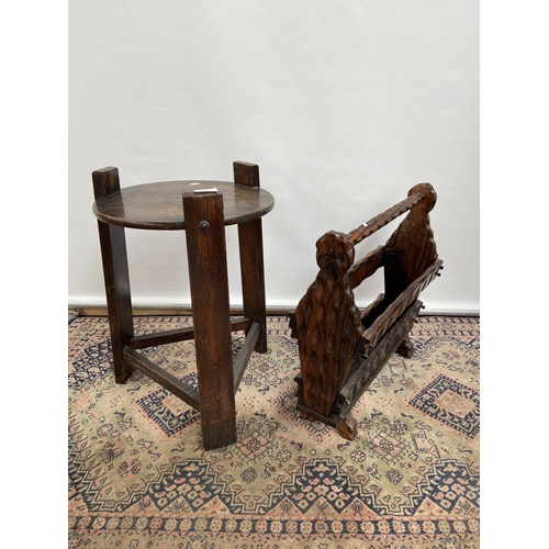146 - An Arts And Crafts side table and hand carved magazine rack. [table 55cm in height & 37cm in diamete...