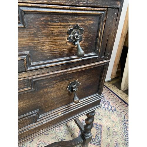 147 - A 1930's 40's oak two drawer writing bureau. Designed with barley twist leg supports. [98x89x42cm]...