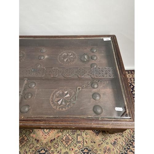 149 - An original Saudi Arabia door made into a coffee table. [41x120x52cm]