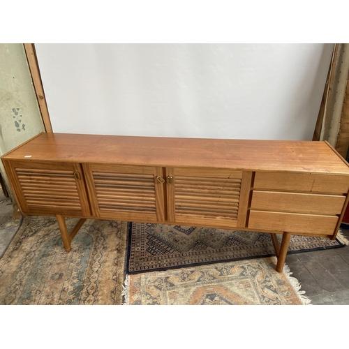165 - A Mid century Retro teak sideboard produced by A.H. McIntosh of Kirkcaldy. [77x200x45cm]
