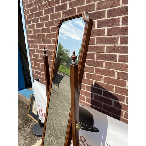 241 - An antique mahogany framed, full-length mirror with bevel edge, upon brass castors [163 x 42cm]