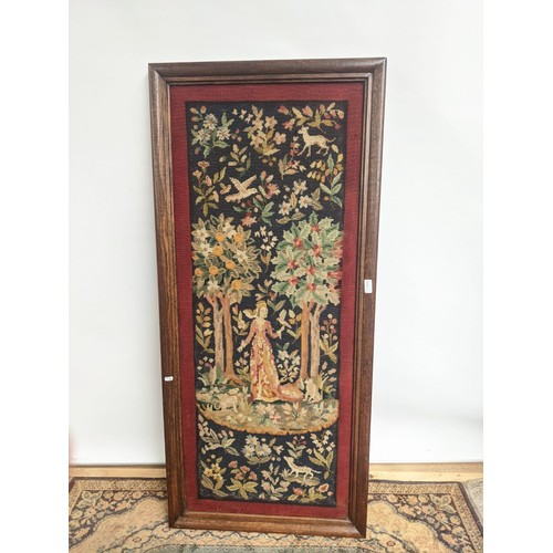 5 - A 19th century rectangular oak framed tapestry, telling the story of a lady of importance surrounded...