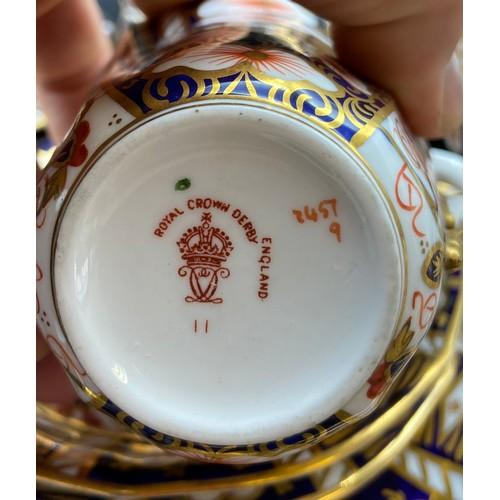 33 - A 23 Piece Royal Crown Derby tea set in an Imari pattern.