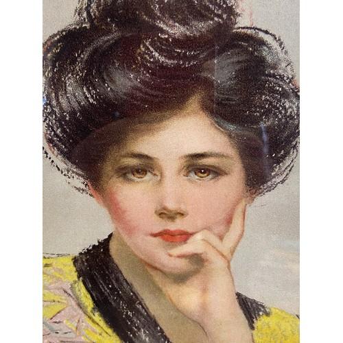 39 - An Art Nouveau design poster depicting a women posing. [Frame measures 50x37cm]