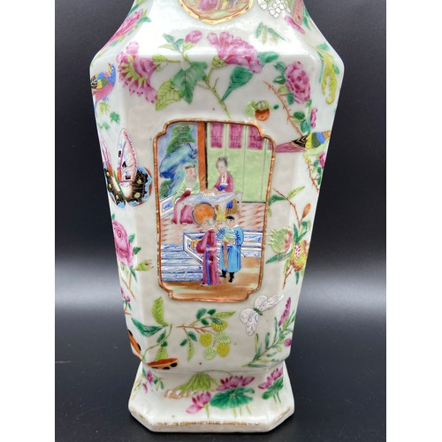 42 - A 19th century Chinese Famille Rose hand painted panel vase. Depicting various figures of importance...