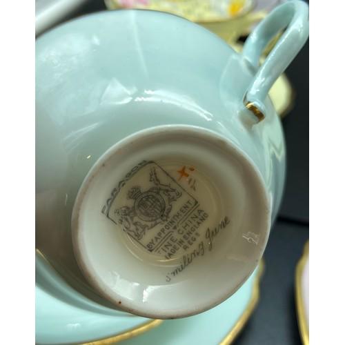 43 - A Vintage Paragon Harley Quinn floral design tea set titled 'Smiling June' together with a Royal Dou...