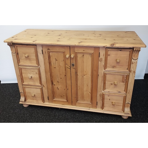 1 - An Antique farm house pine sideboard designed with 6 drawers and two door storage area. [93x140x52cm...