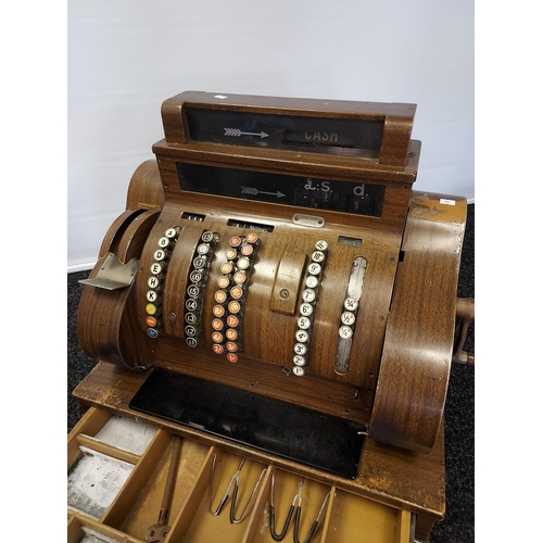 11 - A vintage 'National' cash register. [60x64x41cm]